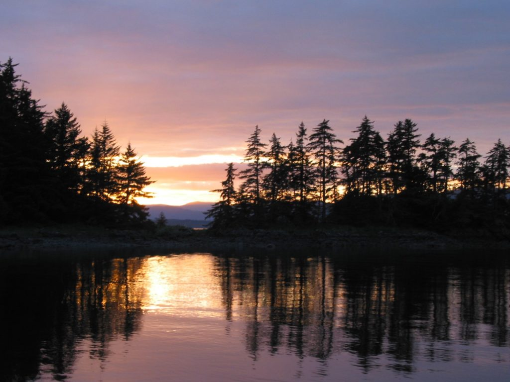 Anchored in a protected cove, guests on the Northern Song are treated to another gorgeous sunset with a beautiful reflection on calm waters.